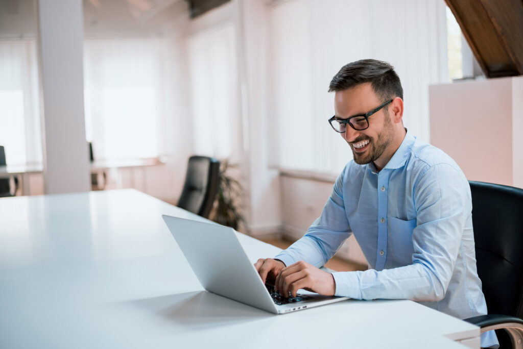 man on laptop using automated processes