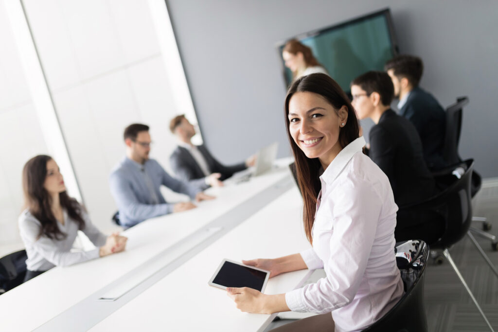 smiling business woman at meeting