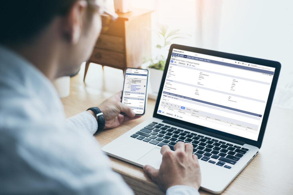 netsuite user on laptop and mobile versions